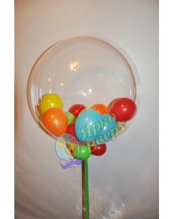 Большой прозрачный шар с маленькими шариками.